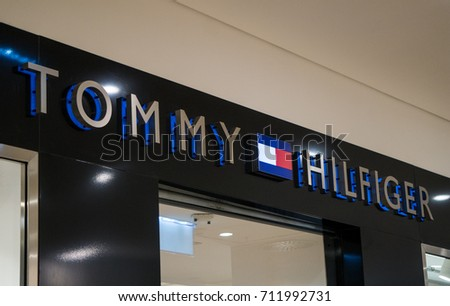 Graz, Austria - September 8th 2017: Tommy Hilfiger logo above the store entrance at Seiersberg Shopping Center