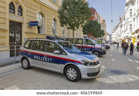 GRAZ, AUSTRIA - SEPTEMBER 11, 2015: Unrecognized people walk along Schmiedgasse street and local police station in Graz Old Town. Graz is the capital of Styria and second largest city in Austria. - stock photo
