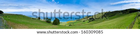 Grazing sheep on the meadows with Rustic fence,panorama,Canterbury,South island, New Zealand  - stock photo