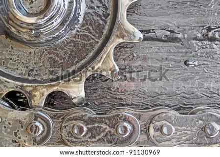greasy cog wheel and chain - stock photo