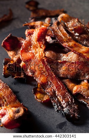 Greasy Hot Grilled Bacon Ready to Eat - stock photo