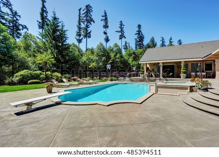 Nice Great Backyard With Swimming Pool .American Suburban Luxury House.  Northwest, USA