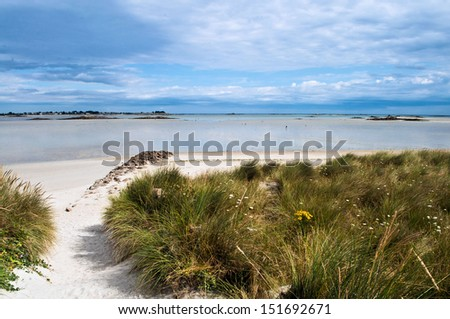 Great beach and dunes during tide in the Bretagne in France  - stock photo