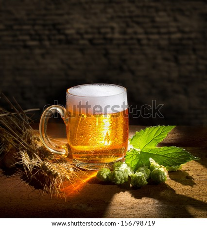great beer and hops still life - stock photo