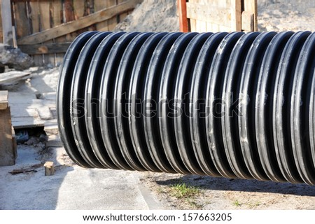 Great black PVC pipe on construction site - stock photo