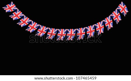 Great Britain British Flag pennants buntings isolated on black background with room for your text - stock photo