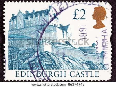 GREAT BRITAIN - CIRCA 1988:  A stamp printed in Great Britain shows Edinburgh Castle in Scotland on top of a hill, circa 1988. - stock photo