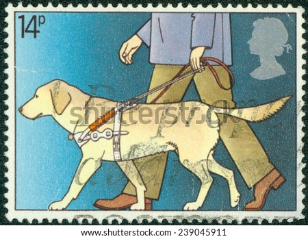 GREAT BRITAIN - CIRCA 1981: a stamp printed in the Great Britain shows Guide Dog Leading Blind Man, International Year of the Disabled, circa 1981 - stock photo