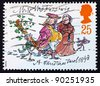 GREAT BRITAIN - CIRCA 1993: a stamp printed in the Great Britain shows Mr. and Mrs. Fezziwig, Christmas carol by Charles Dickens, circa 1993 - stock photo