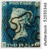 GREAT BRITAIN - CIRCA 1840: A Two Penny Blue, the world's first self-adhesive, pre-paid postage stamp with a black Maltese Cross postmark, Great Britain, circa 1840. - stock photo