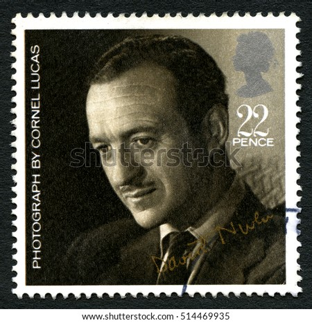 GREAT BRITAIN - CIRCA 1985: A used postage stamp from the UK, depicting a portrait of David Niven - taken by Photographer Cornel Lucas, circa 1985.