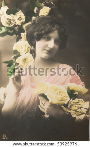 GREAT BRITAIN-CIRCA 1907: hand-painted photograph of Lovely young girl with yellow roses, circa 1907 - stock photo
