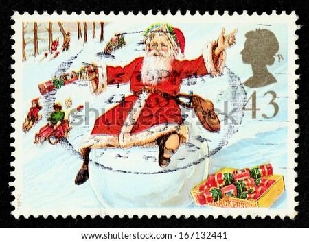 GREAT BRITAIN - CIRCA 1997: Stamp printed in Great Britain with image of Father Christmas on Snowball from Christmas series for 150th Anniversary of the Christmas Cracker, circa 1997. - stock photo