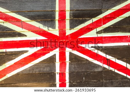 Great britain flag painted on old wood background in Amphawa floating market - stock photo