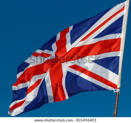 Great Britain Flag with wrinkles and seams expanded in the breeze - stock photo