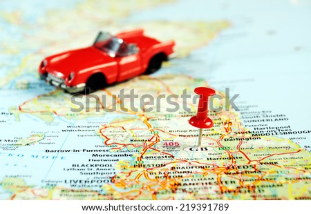 great britain map ,red pin and car - stock photo