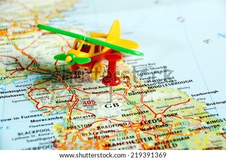 Great Britain  map with red pin and airplane  - Travel concept - stock photo