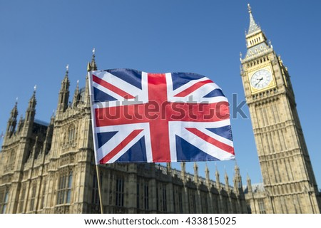 Great British Union Jack flag flying in front of Big Ben and the Houses of Parliament at Westminster Palace, London, in preparation for the Brexit EU referendum - stock photo