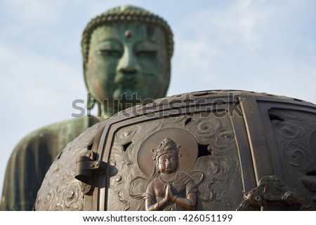 Great Buddha in Kamakura, Japan - detail of bronze incense stand with bodhisattva in front of Amida Buddha, in K?toku-in temple - stock photo