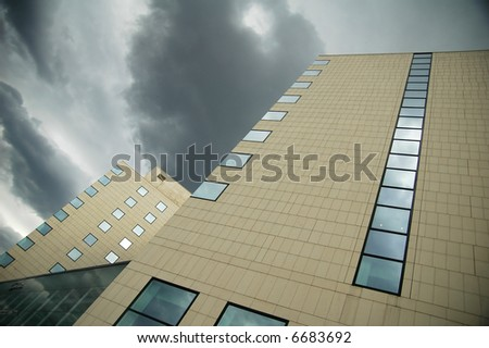 great building against dramatic sky - stock photo