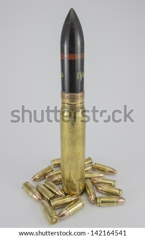 Great bullets 20mm dominating and small 9mm lying down - stock photo