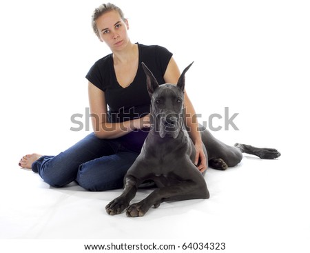 great dane dog laying beside young woman with reflection on white background