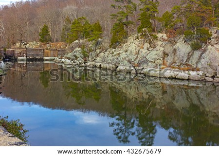 Great Falls National Park in late fall, Virginia USA. Scenic view on canal waters near the old lock. - stock photo