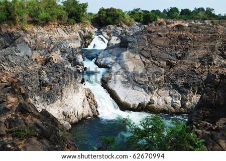 Great flowing waterfall at river Khong - stock photo