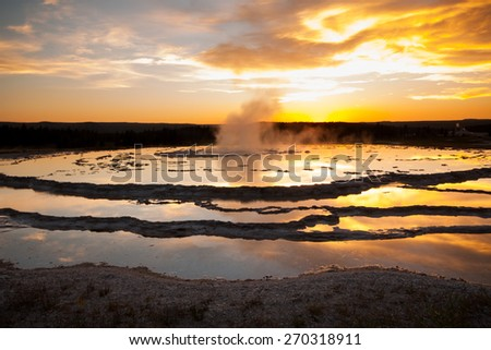 Great Fountain Geyser at Yellowstone National Park Before an Eruption at Sunse - stock photo
