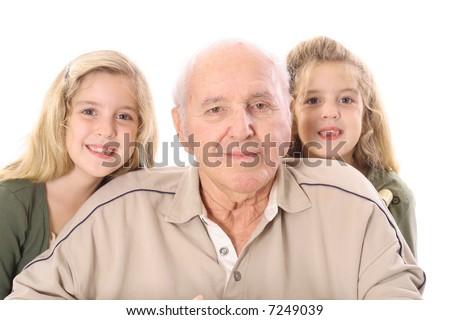 Great grandfather in wheelchair with grandchildren - stock photo