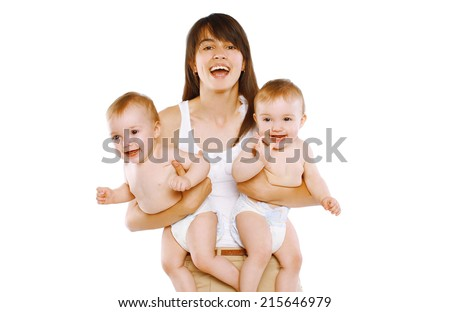 Great happiness, happy mother and twins baby having fun - stock photo