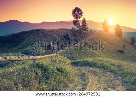 Great hills glowing by warm sunlight at twilight. Dramatic scene. Colorful sky. Carpathian, Ukraine, Europe. Beauty world. Retro and vintage style, soft filter. Instagram toning effect. - stock photo