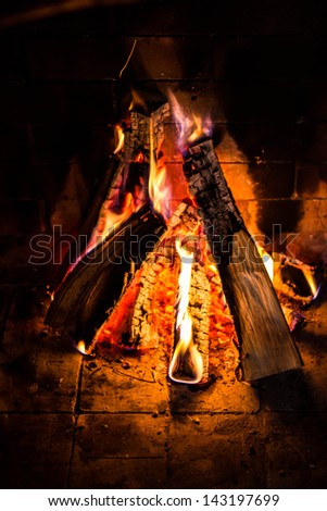 Great Home Firewood burning in brick fireplace - stock photo