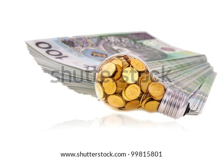 Great idea and glass bulb with many golden coins - stock photo