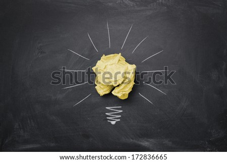 Great idea concept, crumpled paper on the chalkboard turned into a light bulb - stock photo