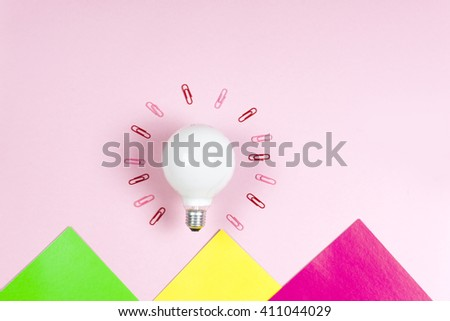 great idea concept with crumpled colorful paper and light bulb on light background. Creative great idea concept with crumpled colorful paper and light bulb on light background.  - stock photo