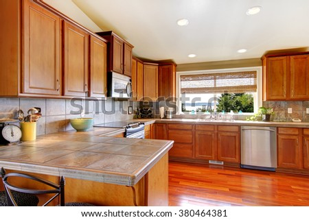 Great kitchen with dark stained hardwood floor.