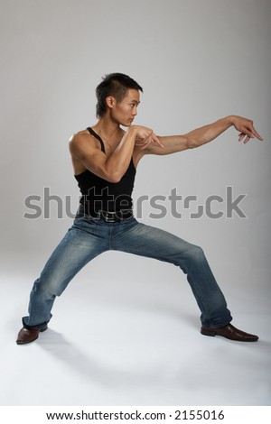 Great looking asian guy shot in studio - martial arts pose