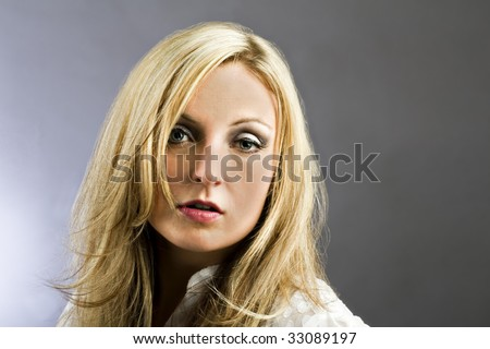 Great looking female model against plain background with copy space.