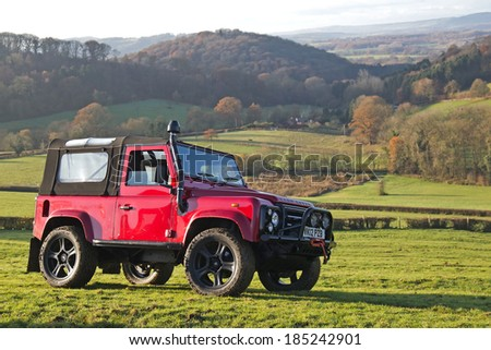 GREAT MALVERN, UK - DECEMBER 8: A red Land Rover is parked on a steep hillside at the beginning of stage 1 of the MROC Croft Farm 4x4 trial on December 8, 2013 in Great Malvern - stock photo