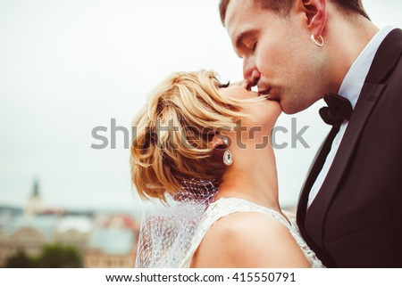 great  married couple kissing on the street - stock photo