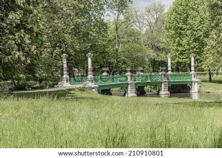 Great Men's Bridge in English Garden (Jardin Anglais, 1817). Famous Chateau de Chantilly (Chantilly Castle, 1560) - historic chateau, town of Chantilly, Oise, Picardie, France.