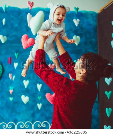 great mom enjoys her  excellent little baby - stock photo
