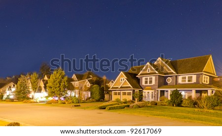 Great neighborhood at the night time. The suburb houses at sunrise-sunset night time.