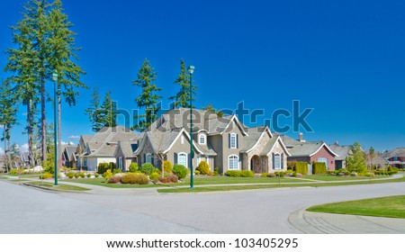 Great neighborhood. Empty street ( homes )  in suburbs  in the north America - stock photo