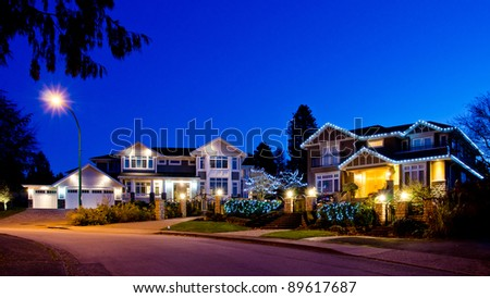 Great neighborhood. Houses in suburbs at dusk in Vancouver, Canada - stock photo