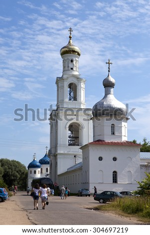 GREAT NOVGOROD - JULY 22: Tourists and believers go to Yuryev monastery, Russian Orthodox Church, on July 22, 2010 in Great Novgorod, Russia - stock photo