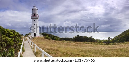 Great ocean road Otway Lighthouse panoramic view to ocean, sky, green meadow - stock photo