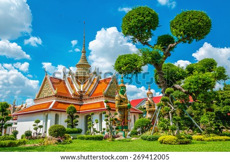 Great Palace Buddhist temple with famous green tree gardens in center of Bangkok, Thailand - stock photo