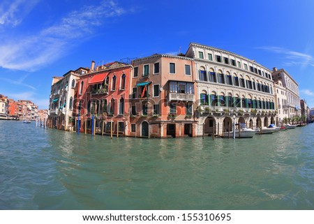 Great photo Venetian palazzo surrounded mirrored waters channel. Photo making the lens Fisheye - stock photo